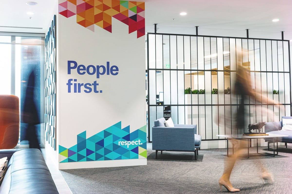 Lady walking past people first poster